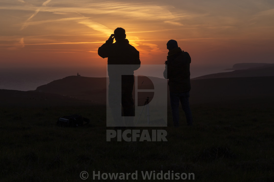 """Watching the sunset"" stock image"