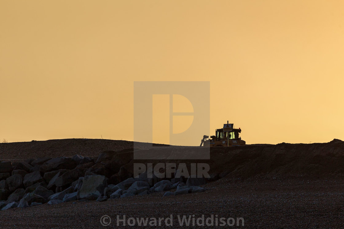 """""""Earth mover on the beach near Sovereign Harbour"""" stock image"""