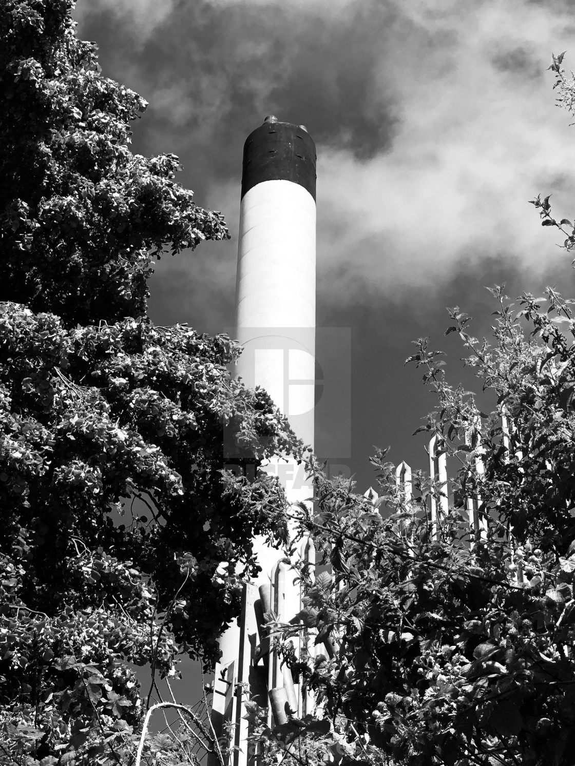 """Hospital furness chimney with moody sky"" stock image"