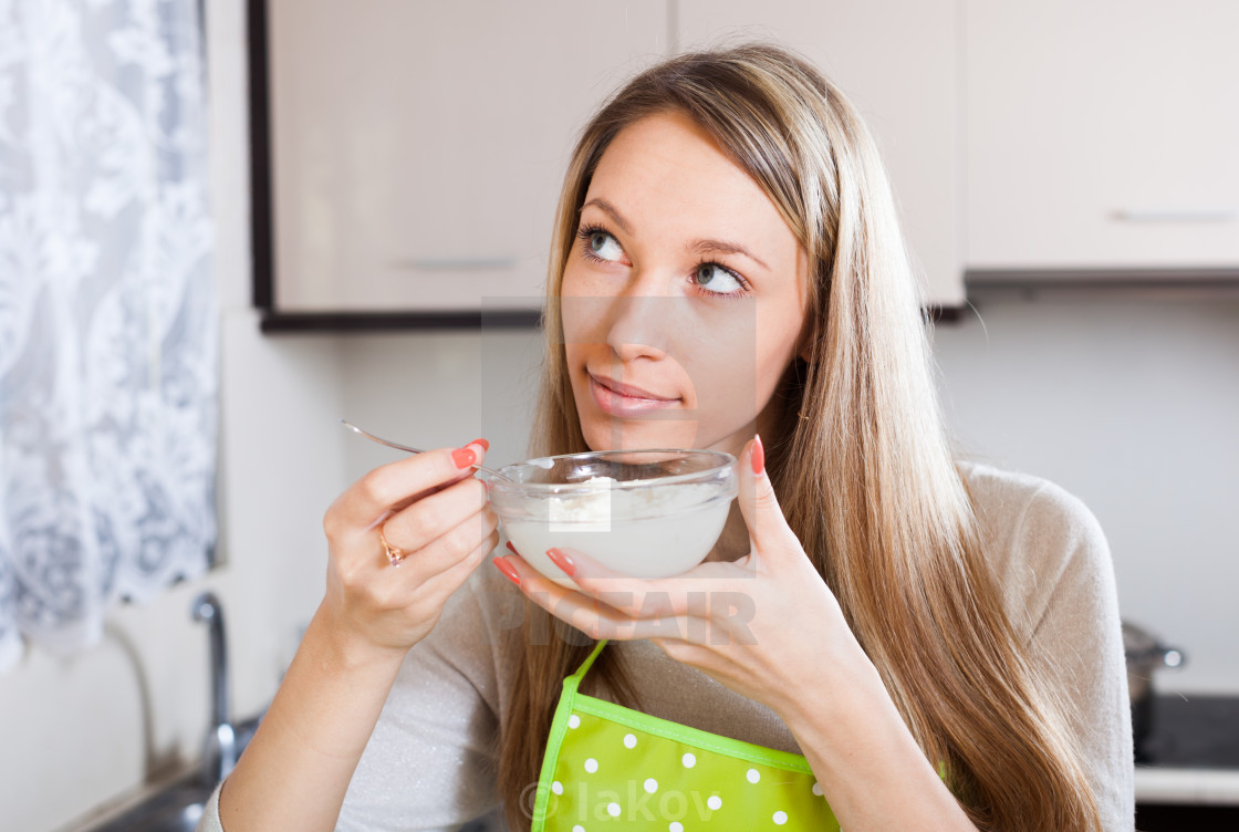 """""""Smiling woman eating curd cheese"""" stock image"""