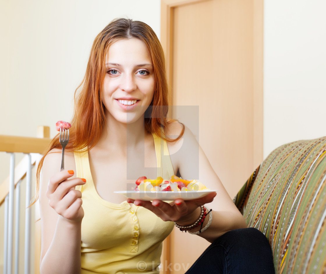 """red-hair girl eating fruits salad"" stock image"