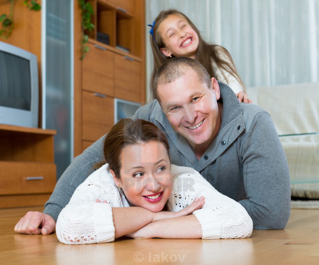 """Portrait of mother, father and girl"" stock image"