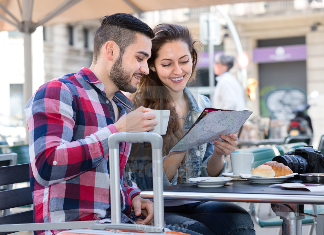 """""""Couple resting in cafe during trip"""" stock image"""