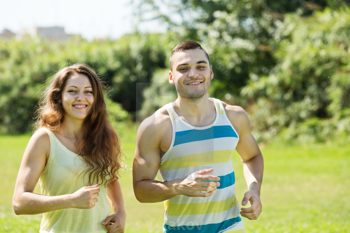 """friends jogging on summer morning"" stock image"
