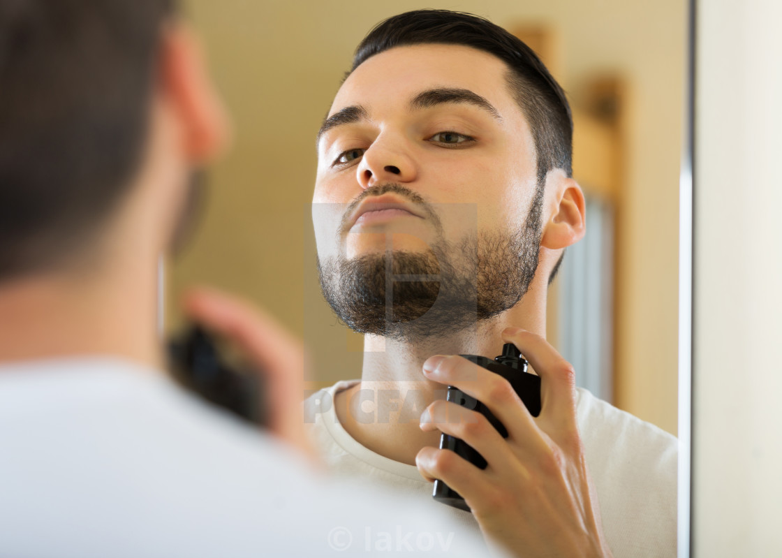 """Man spraying fragrance perfume"" stock image"