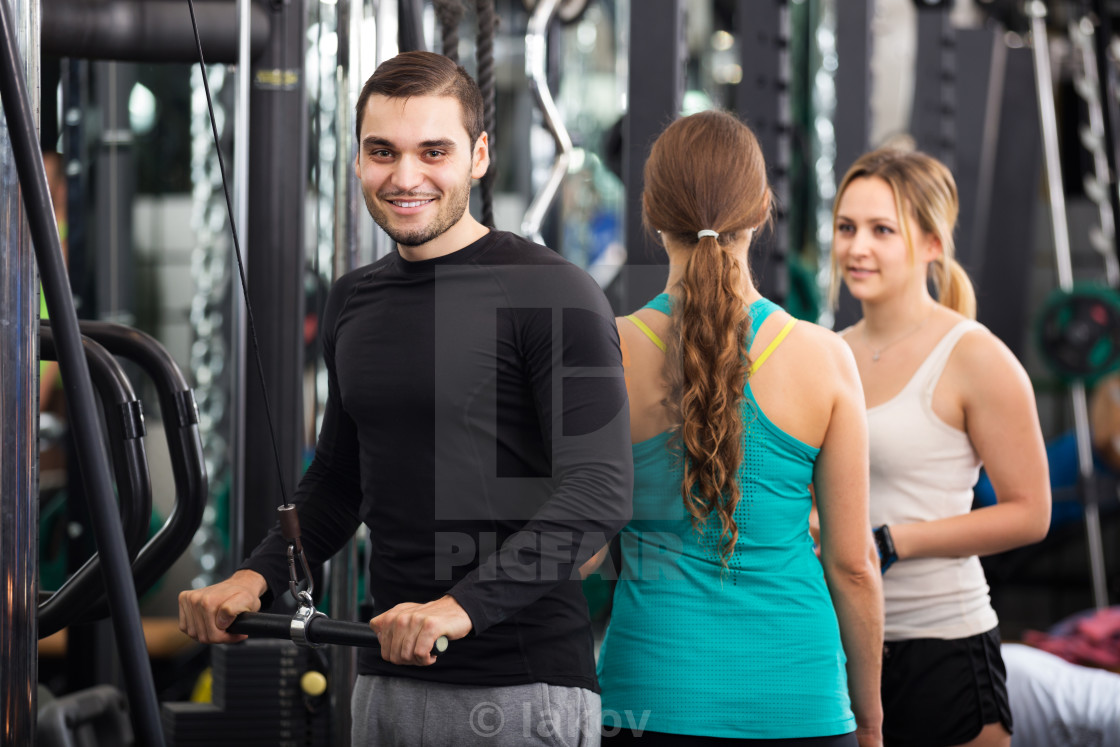 """Adults having strength training"" stock image"