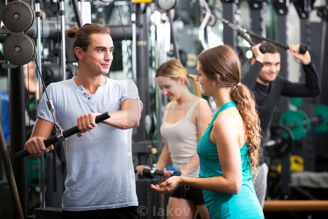 """""""Active people having weightlifting training"""" stock image"""