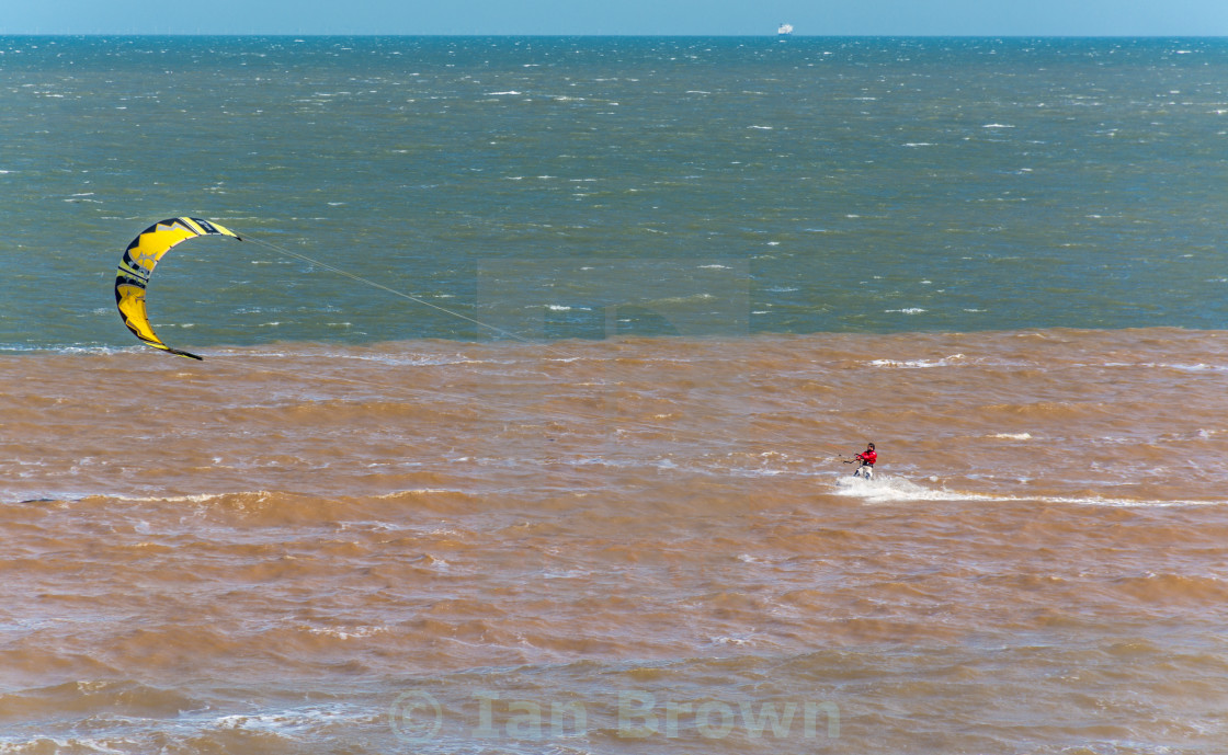 """Kitesurfer heads out to Sea"" stock image"