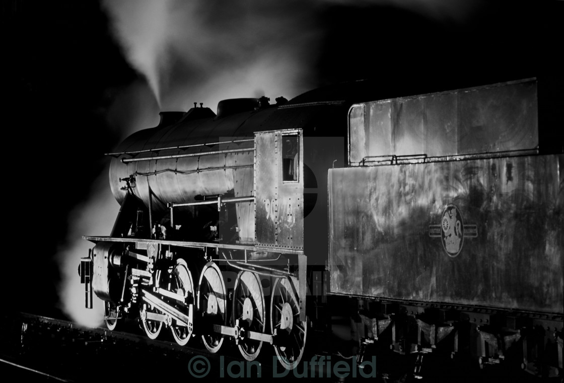 """Austerity locomotive preparing to depart at night"" stock image"