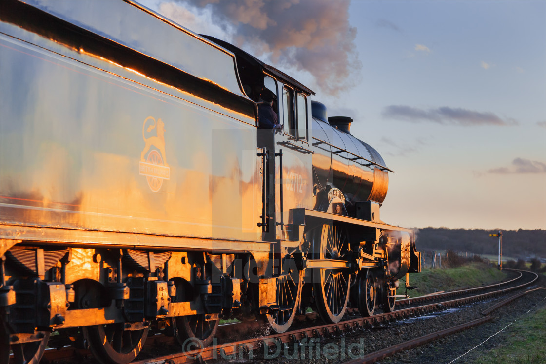 """Steaming into the sunset"" stock image"