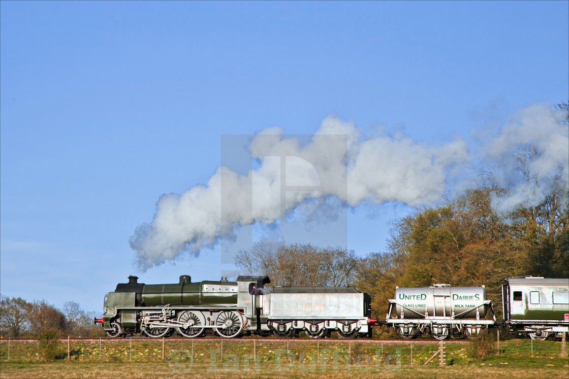 """Steam train catching evening glint"" stock image"