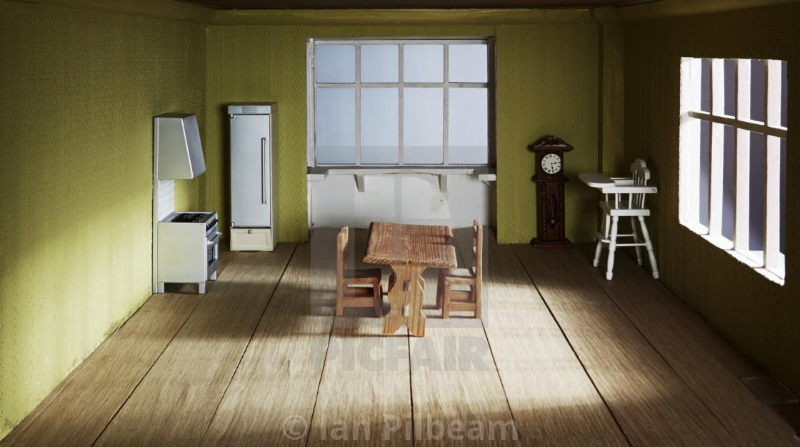 Inside a dolls house kitchen - License, download or print