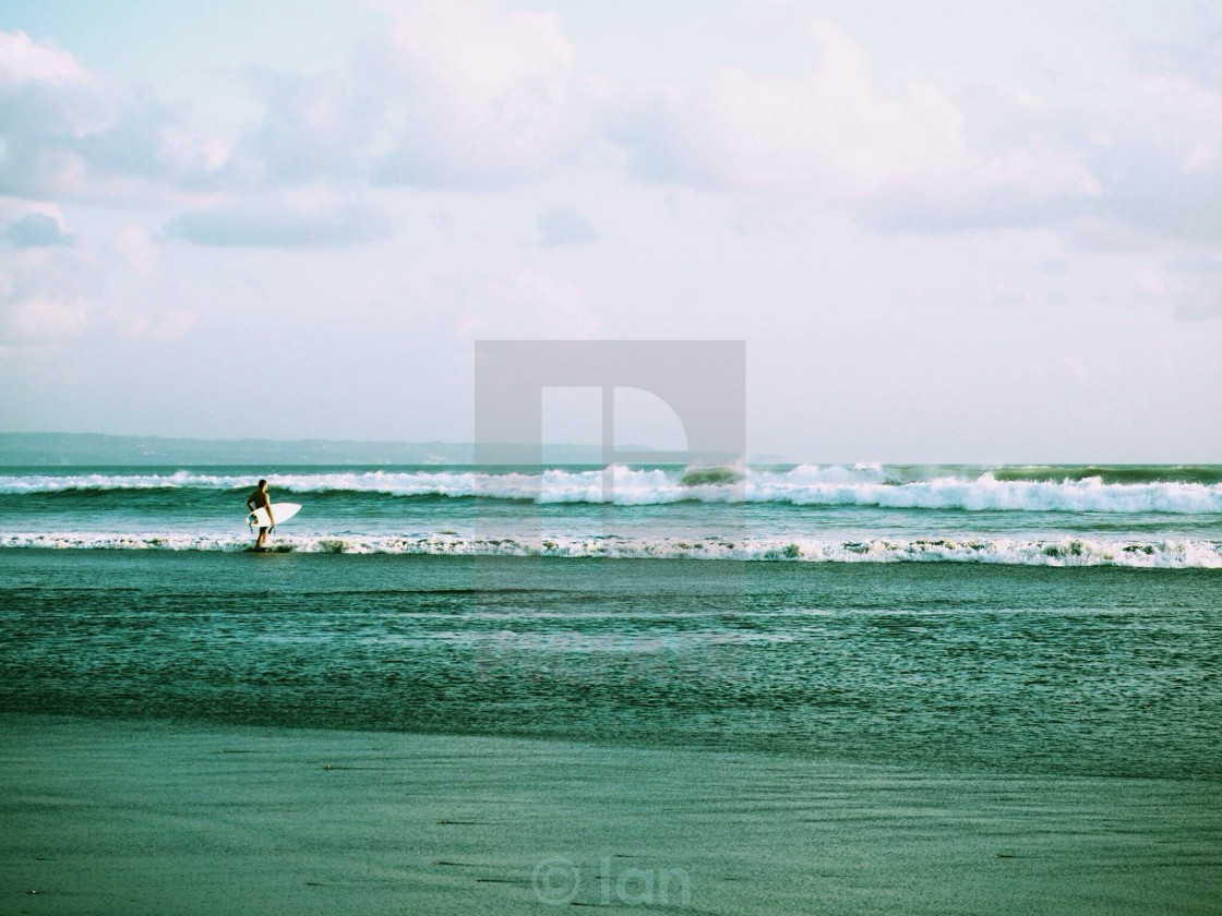 """Should I go out? Surfer in Bali"" stock image"