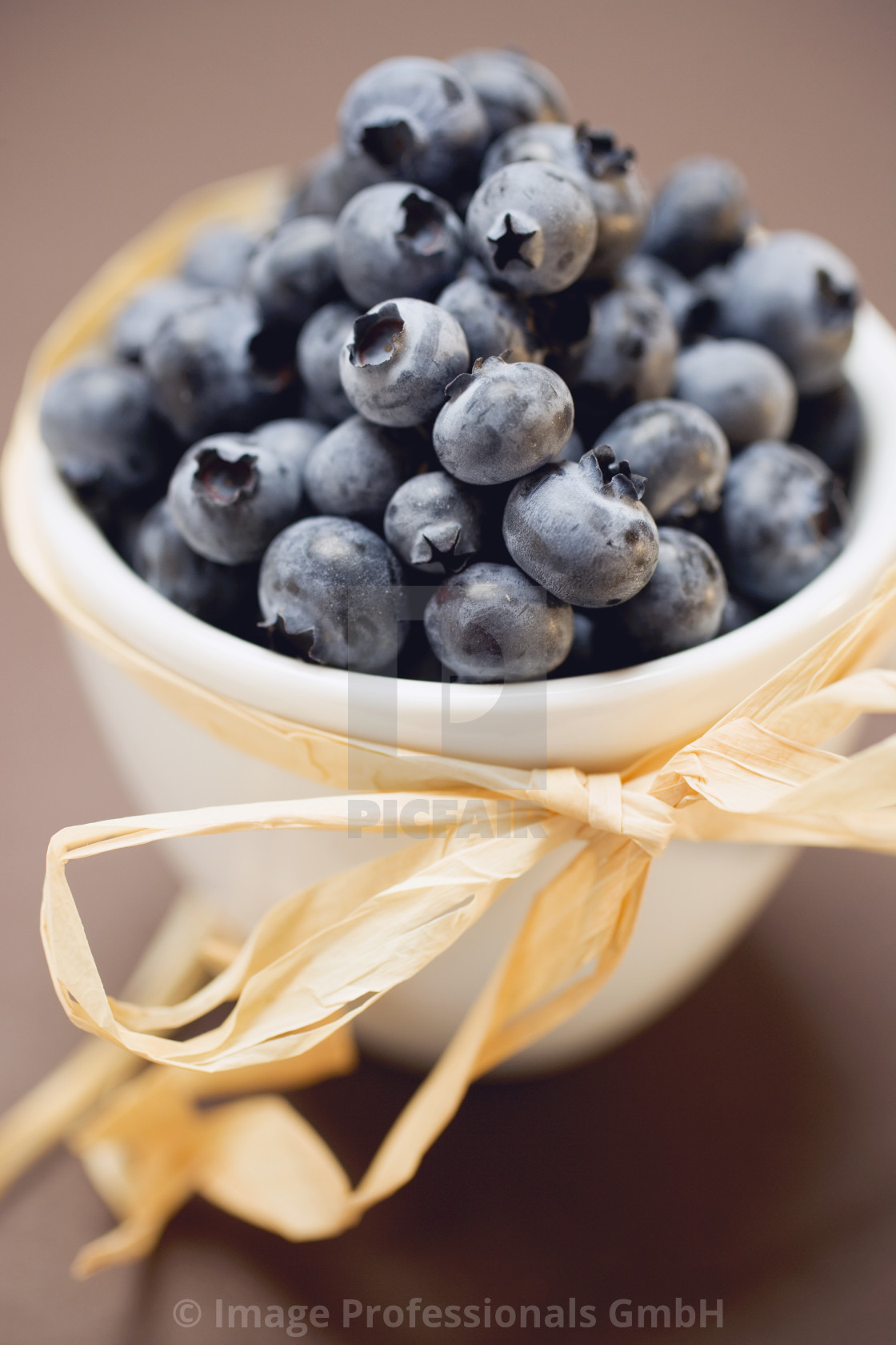 """Blueberries in white bowl to give as a gift"" stock image"