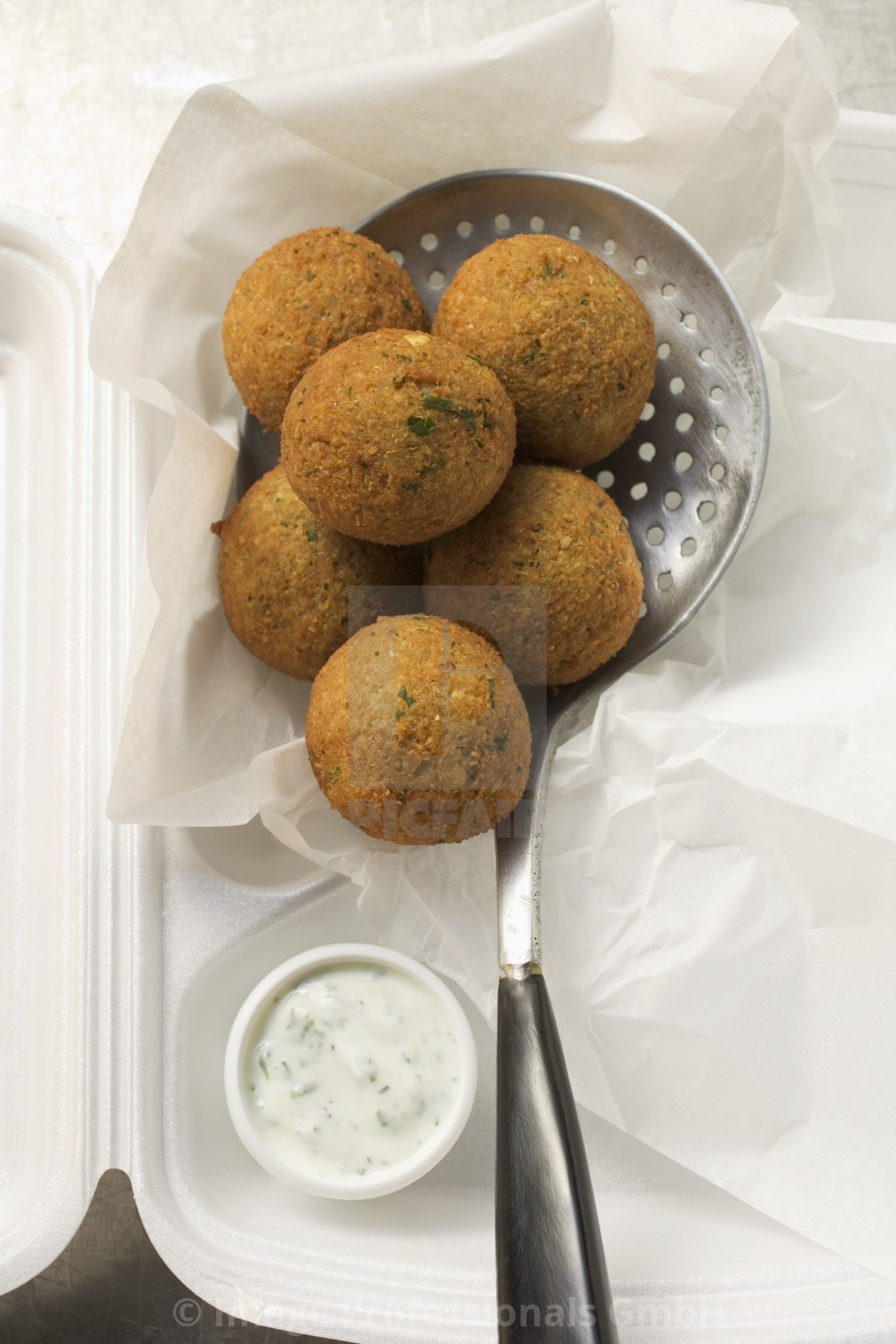 """""""Falafel (chick-pea balls) with yoghurt dip in lunch box"""" stock image"""