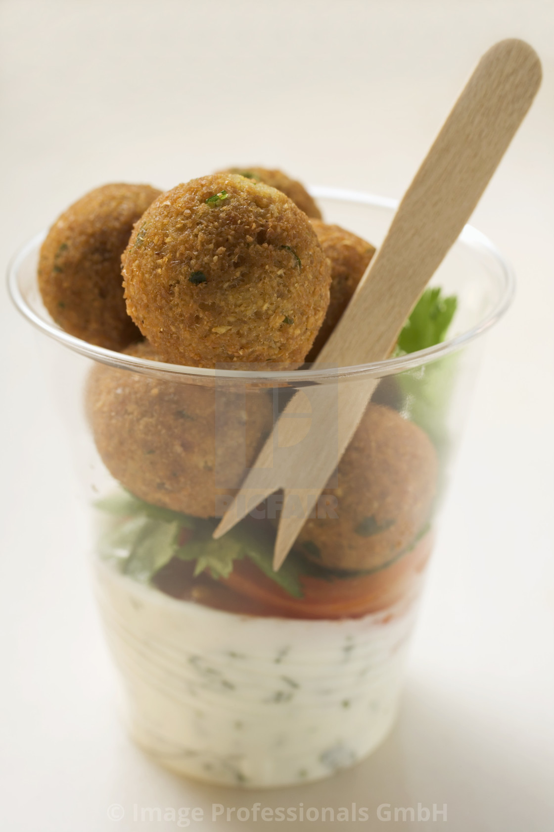 """Falafel (chick-pea balls) with yoghurt sauce in beaker"" stock image"