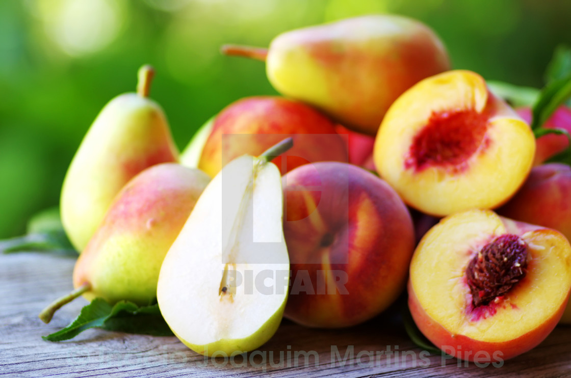 """""""Ripe pears and peaches on table"""" stock image"""