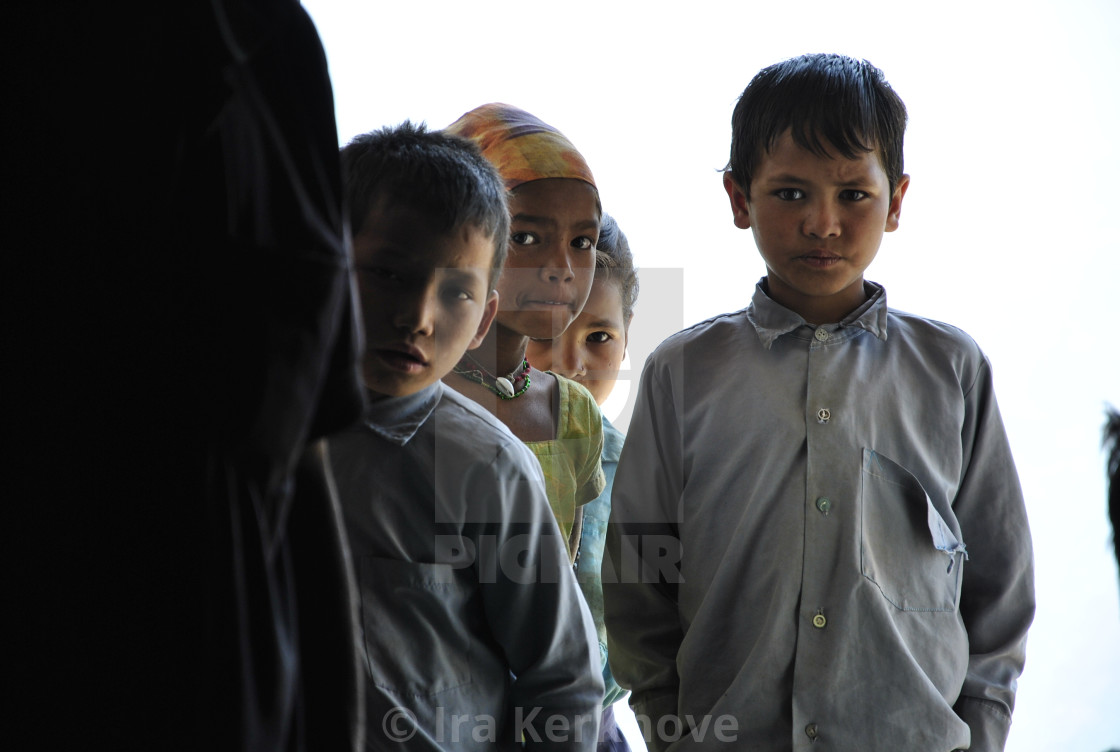 """Nepalese kids looking scared yet brave"" stock image"