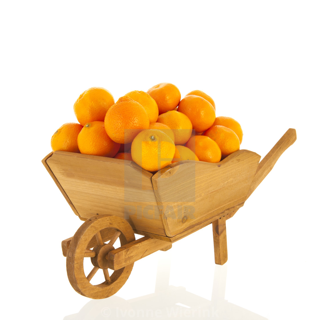 """wheel barrow with tangerines"" stock image"