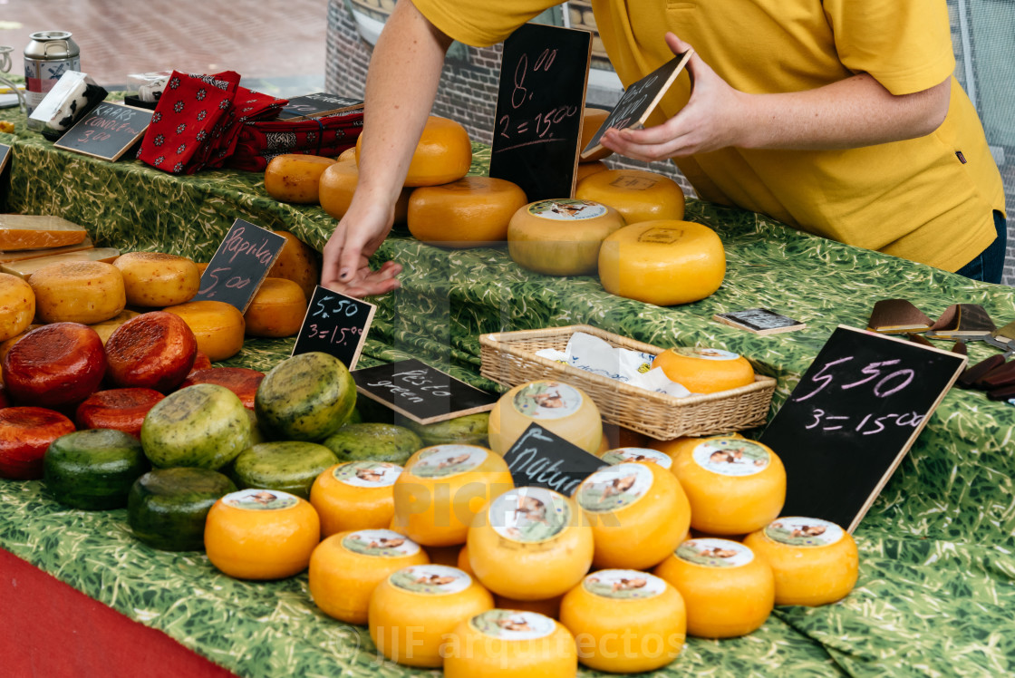 """Traditional producers in Gouda Cheese Market a rainy day"" stock image"