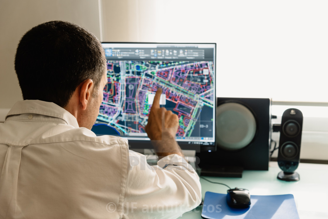 """""""Architect drawing with cad software designing building"""" stock image"""