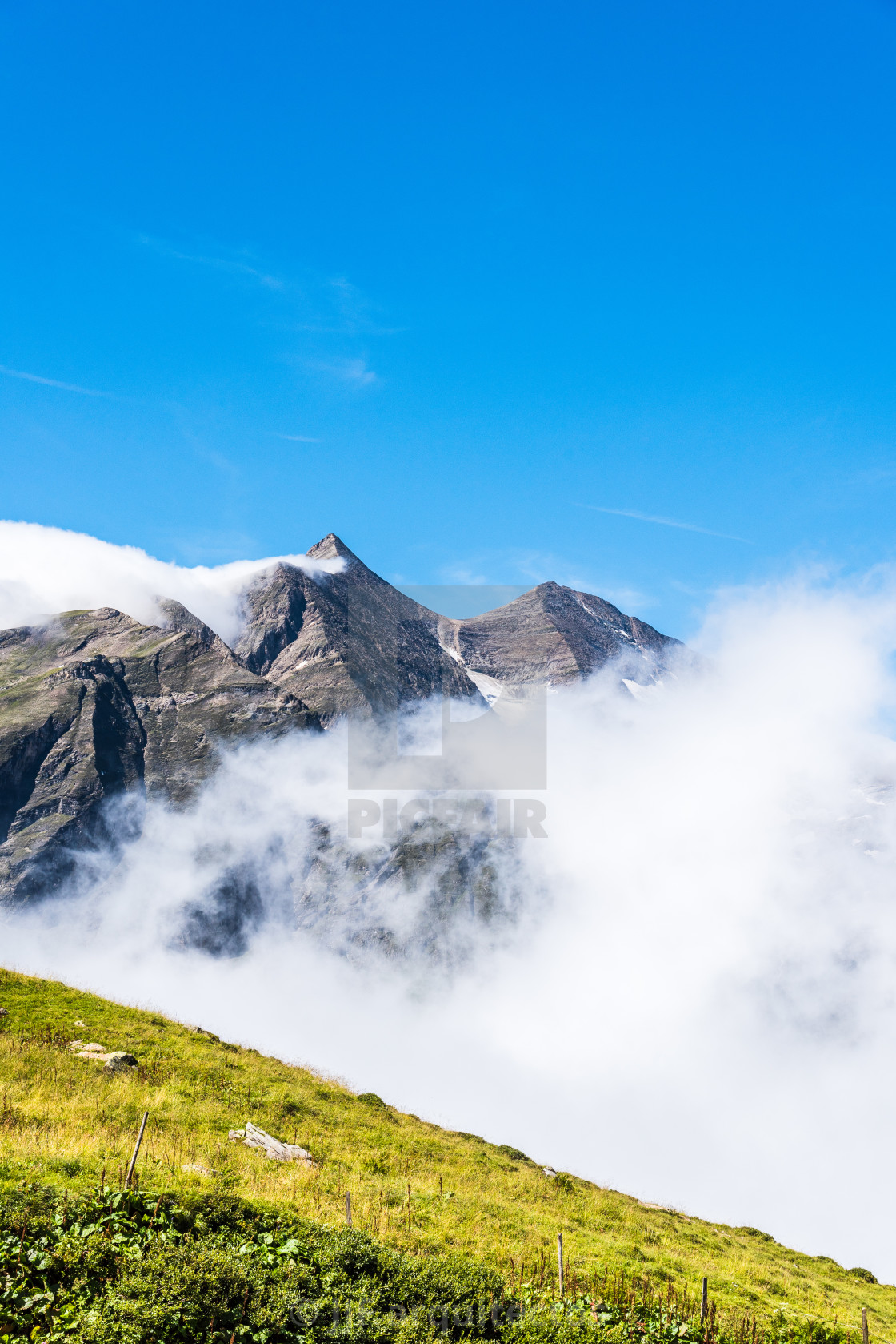 """Scenic view of Alpine valley with sea of clouds"" stock image"