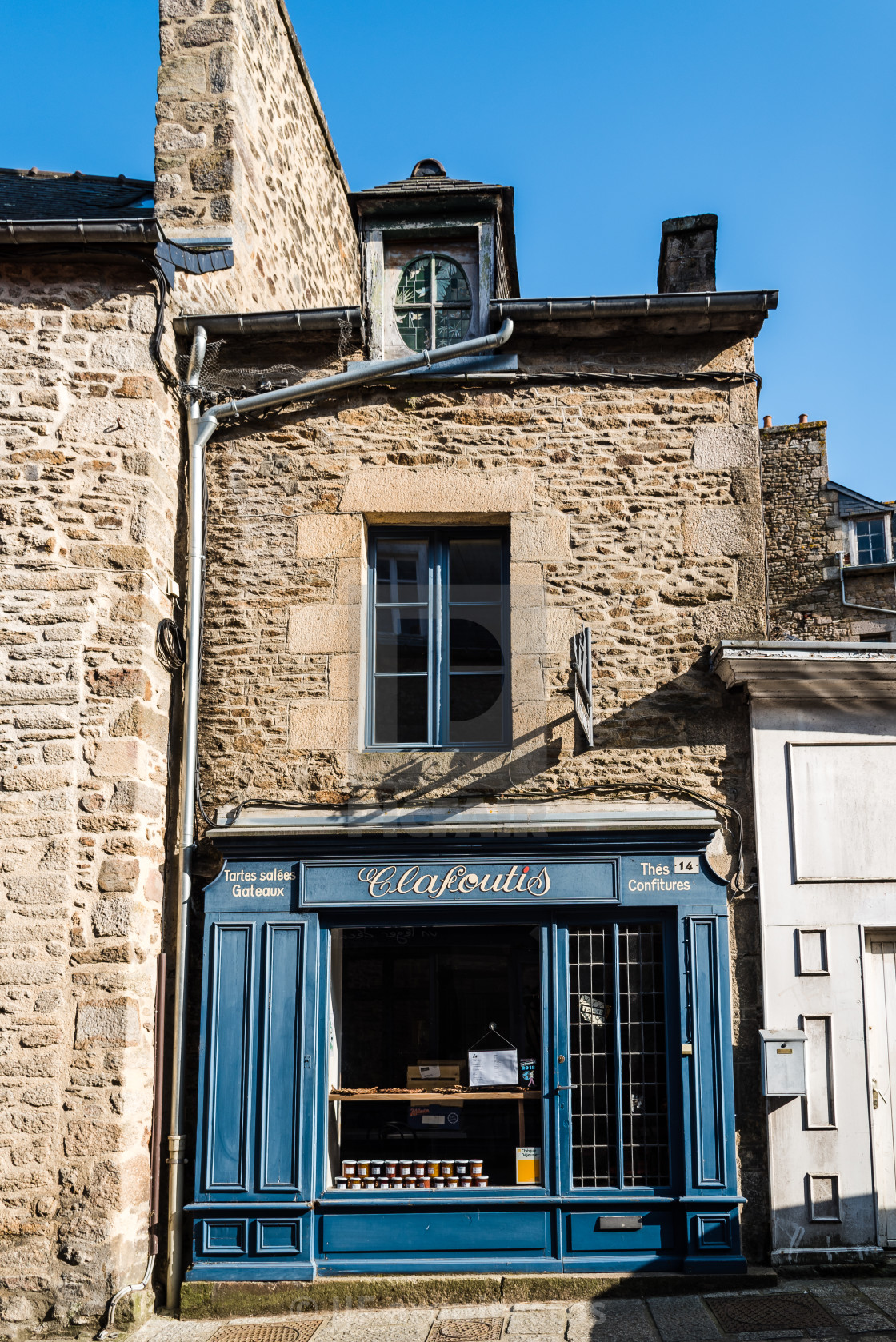"""Picturesque storefront in historic centre of Dinan"" stock image"