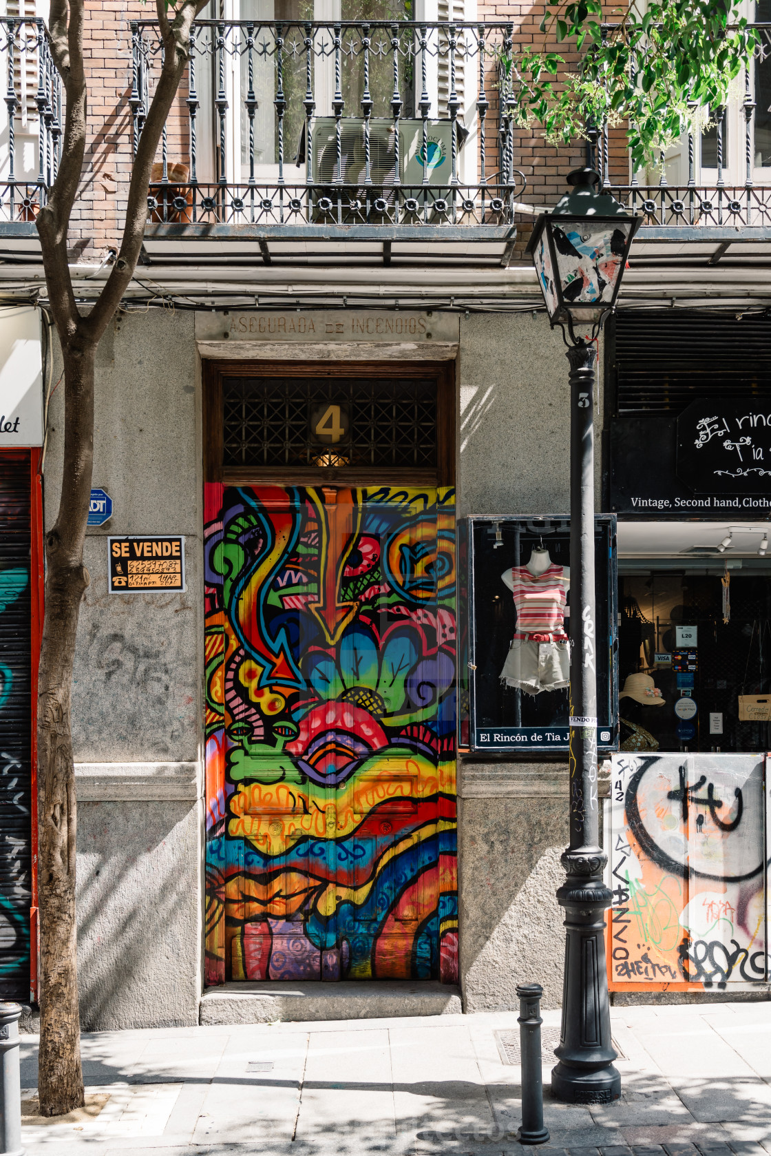 """Colorful storefront in Malasana district in Madrid"" stock image"