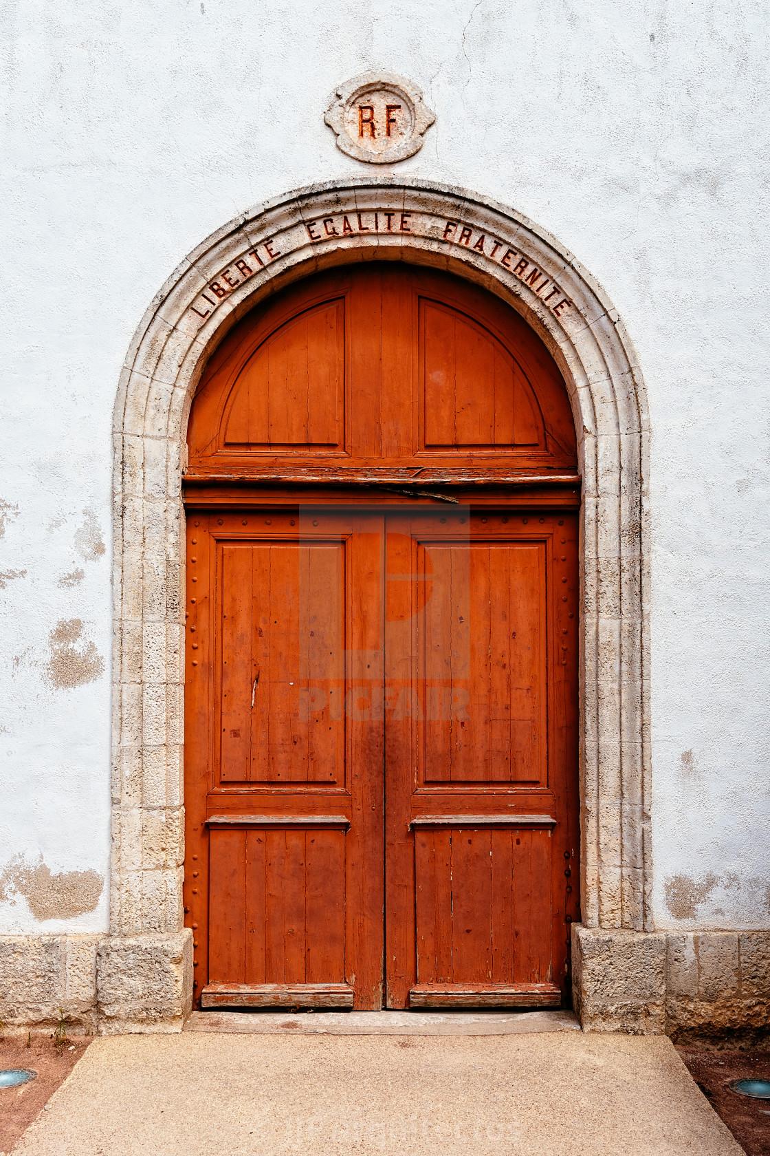 """Beautiful red door in the church of the village Loix-en-Re"" stock image"