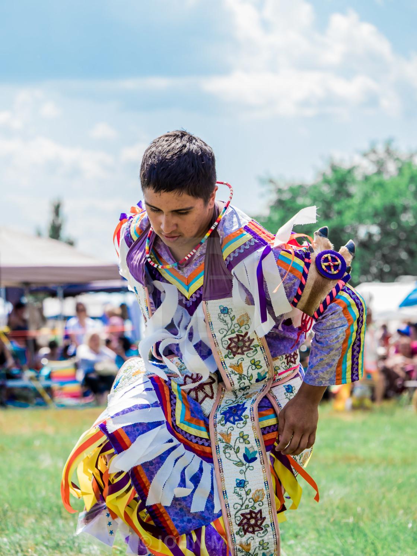 """YOUNG NATIVE AMERICAN MAN DANCING"" stock image"