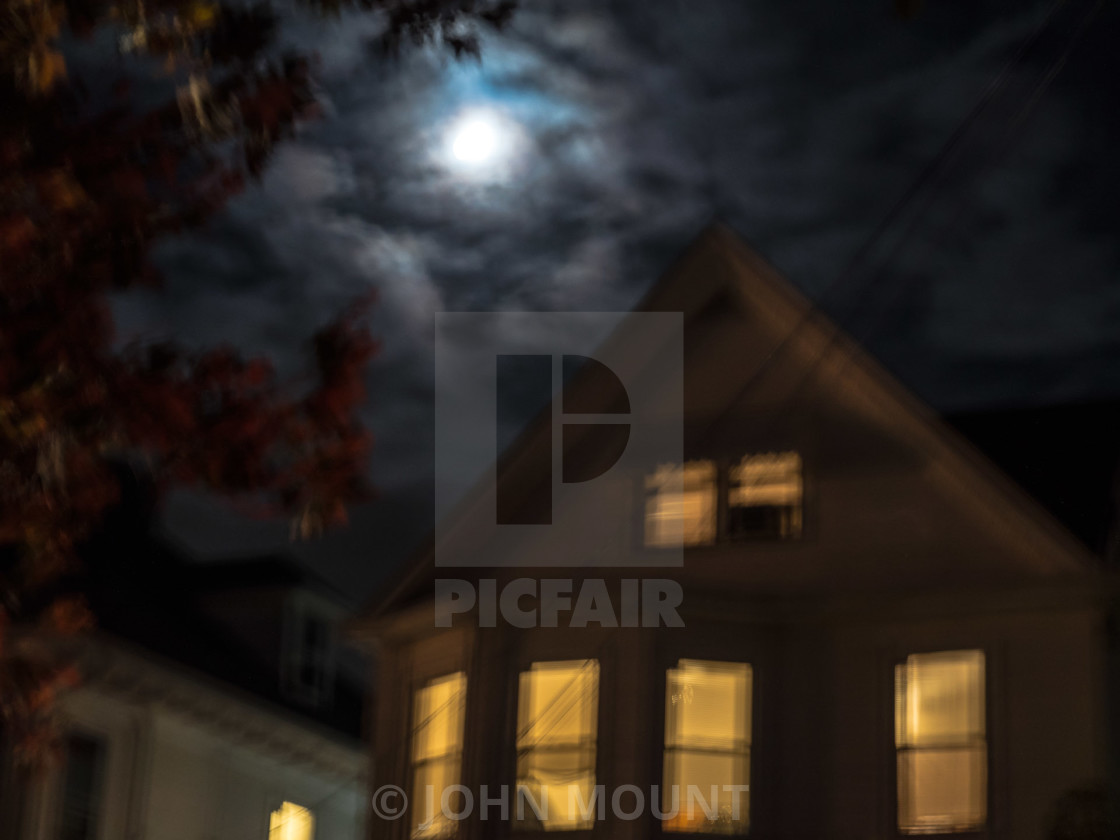 """""""SPOOKY HOUSE WITH CLOUDED MOON"""" stock image"""