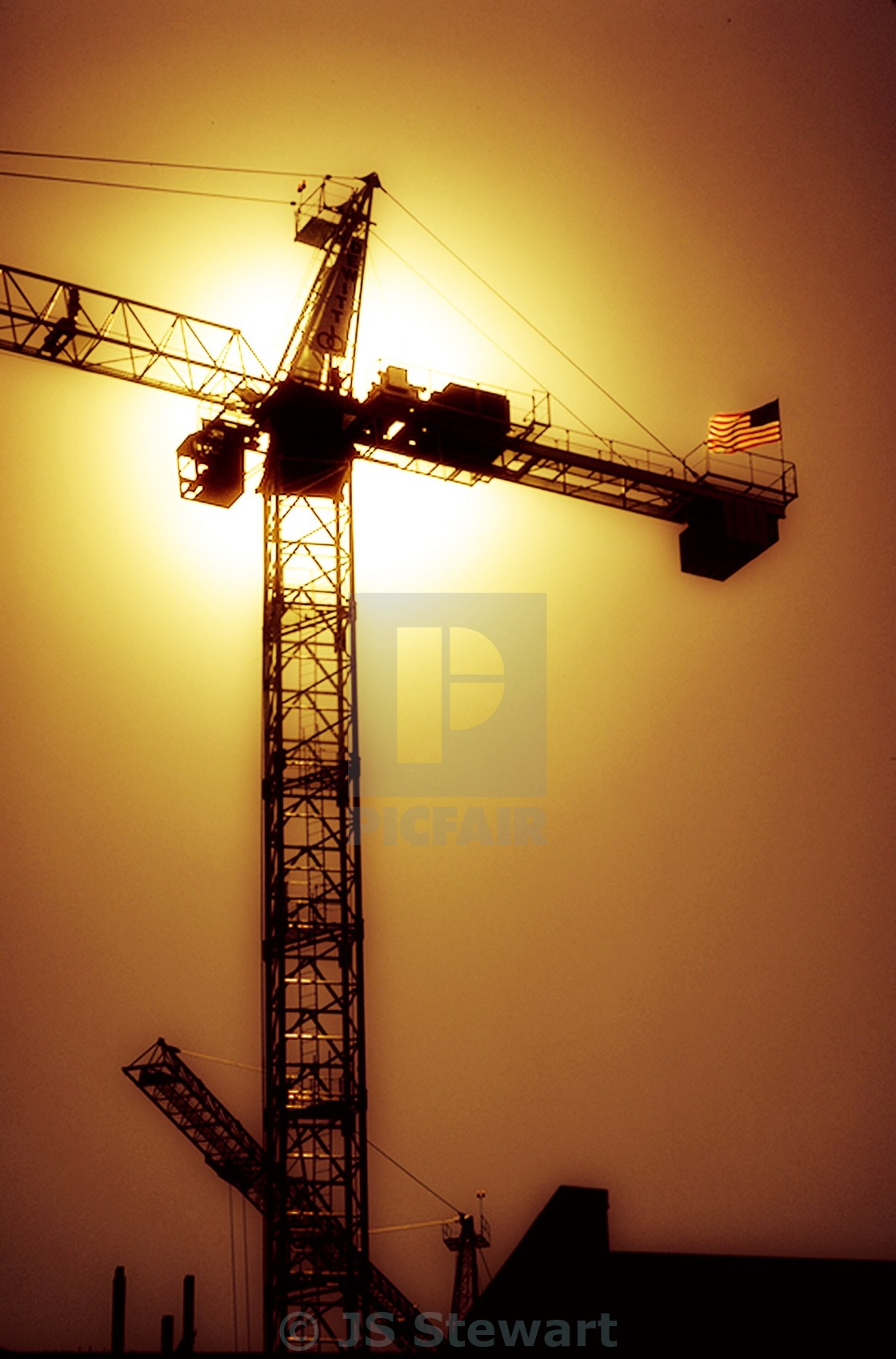 """Amber Sky and Crane"" stock image"