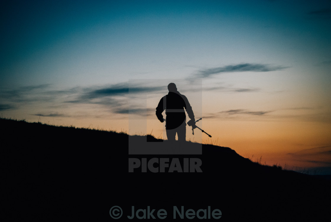 """Photographer, working at sunset"" stock image"
