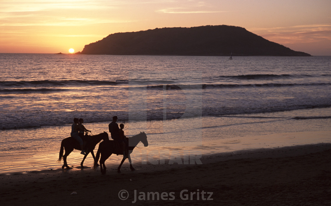"""Horseback riders on beach, Sayulita, Mexico"" stock image"