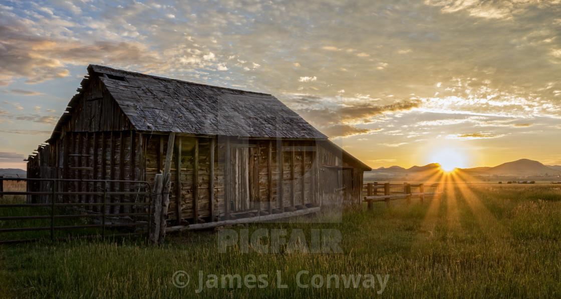 """""""Sunrise behind barn"""" stock image"""