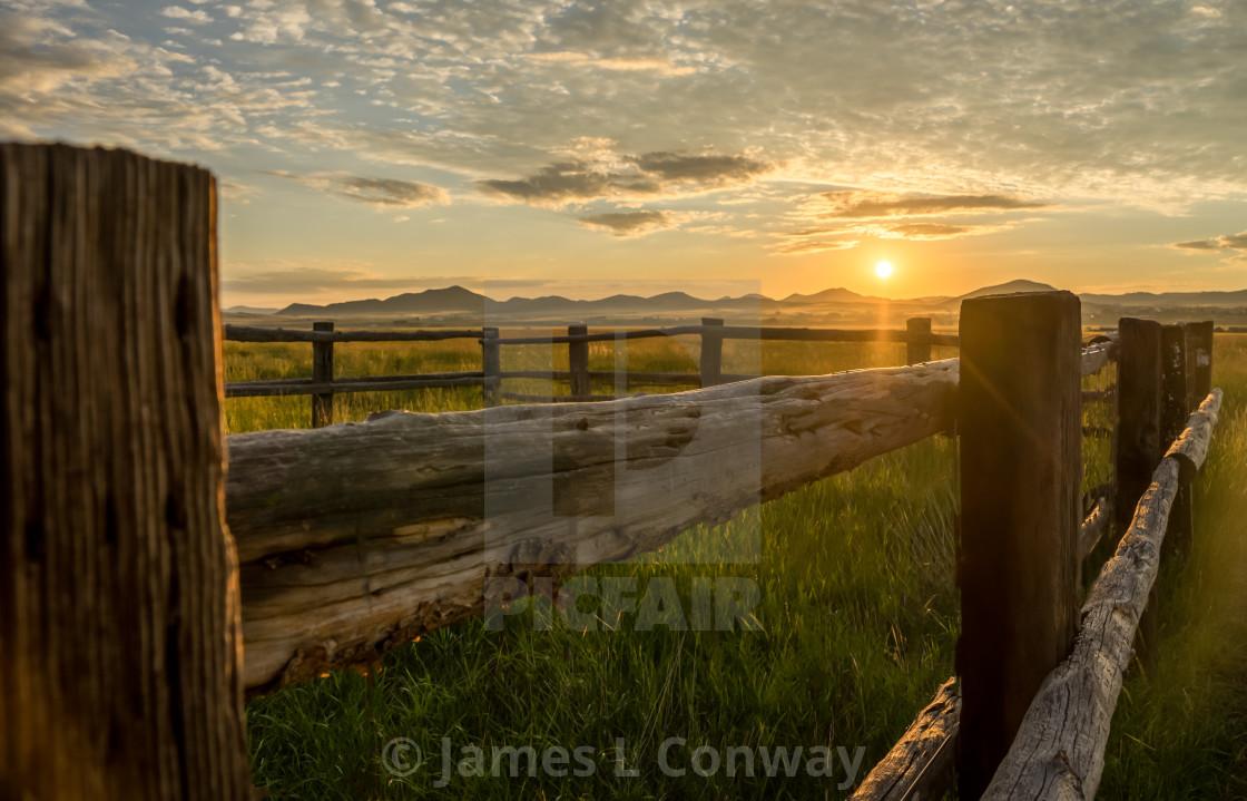 """A fence at sunrise"" stock image"
