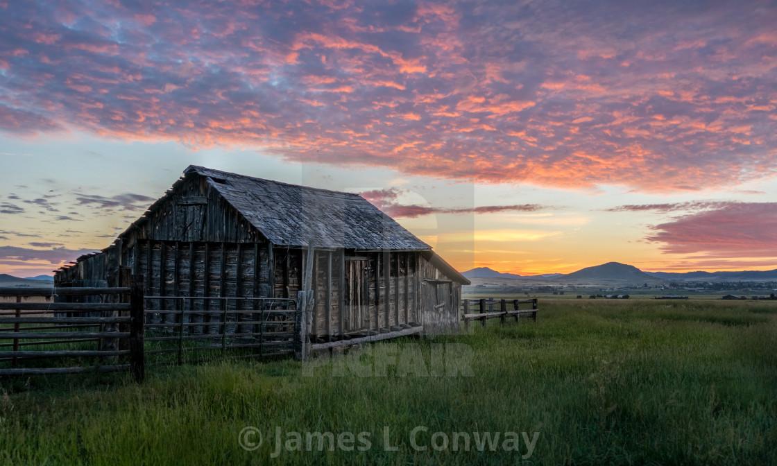 """A barn at sunrise"" stock image"