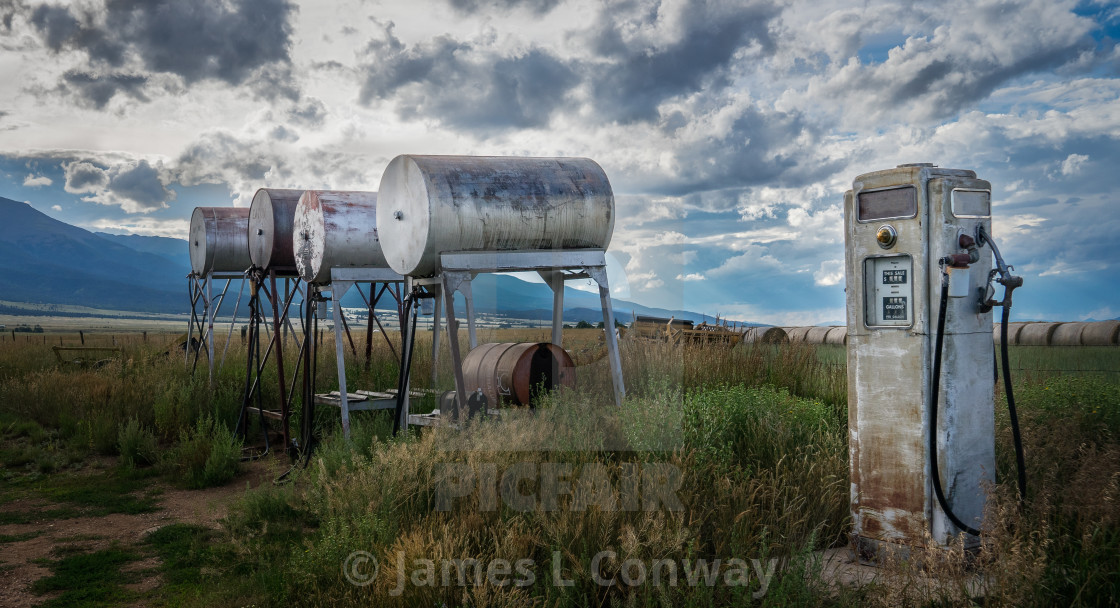 """Antique Gas Pump and Tanks on Ranch"" stock image"