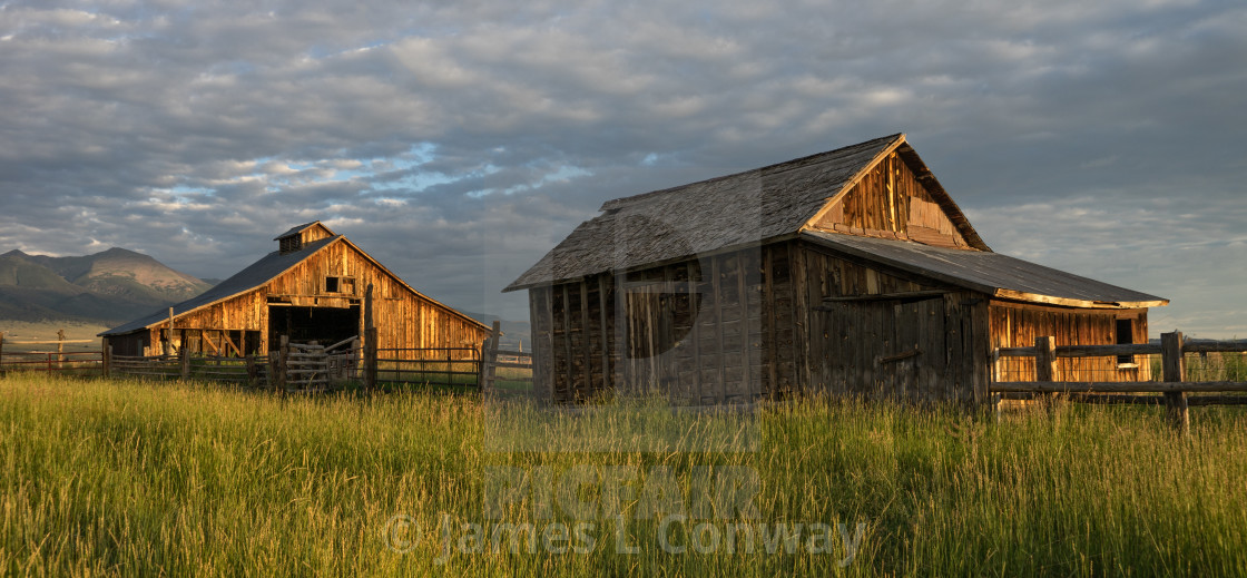 """Barns at sunrise"" stock image"