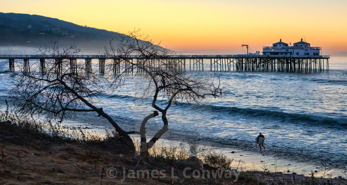 """Malibu Pier and surfer at Sunrise"" stock image"
