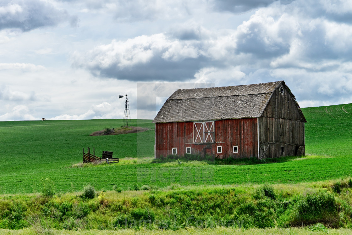 """""""A red barn in Field."""" stock image"""