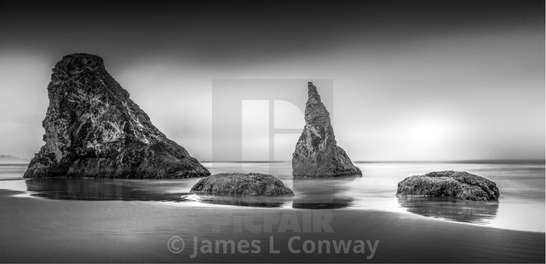 """Black and White Sea Stacks"" stock image"