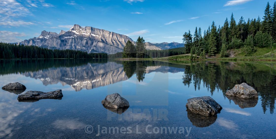 """Stones and Mountain Lake Reflection"" stock image"