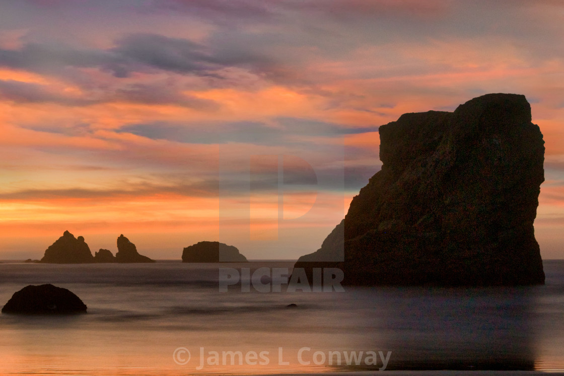"""Sunset on Sea Stacks"" stock image"