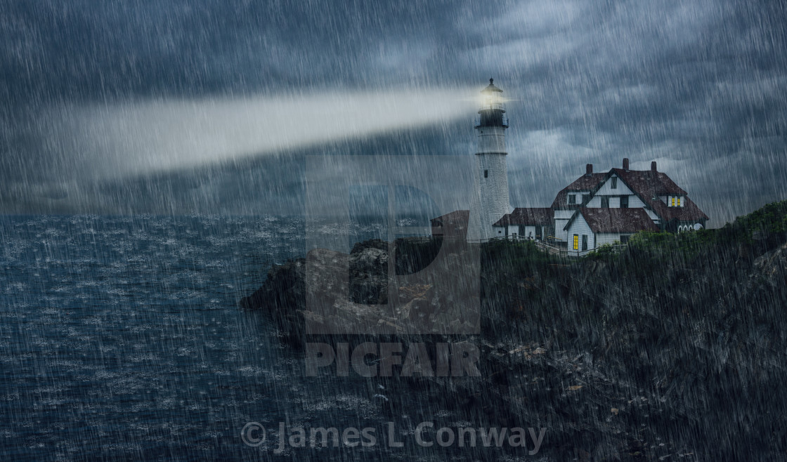 """""""Lighthouse at night in rainstorm"""" stock image"""
