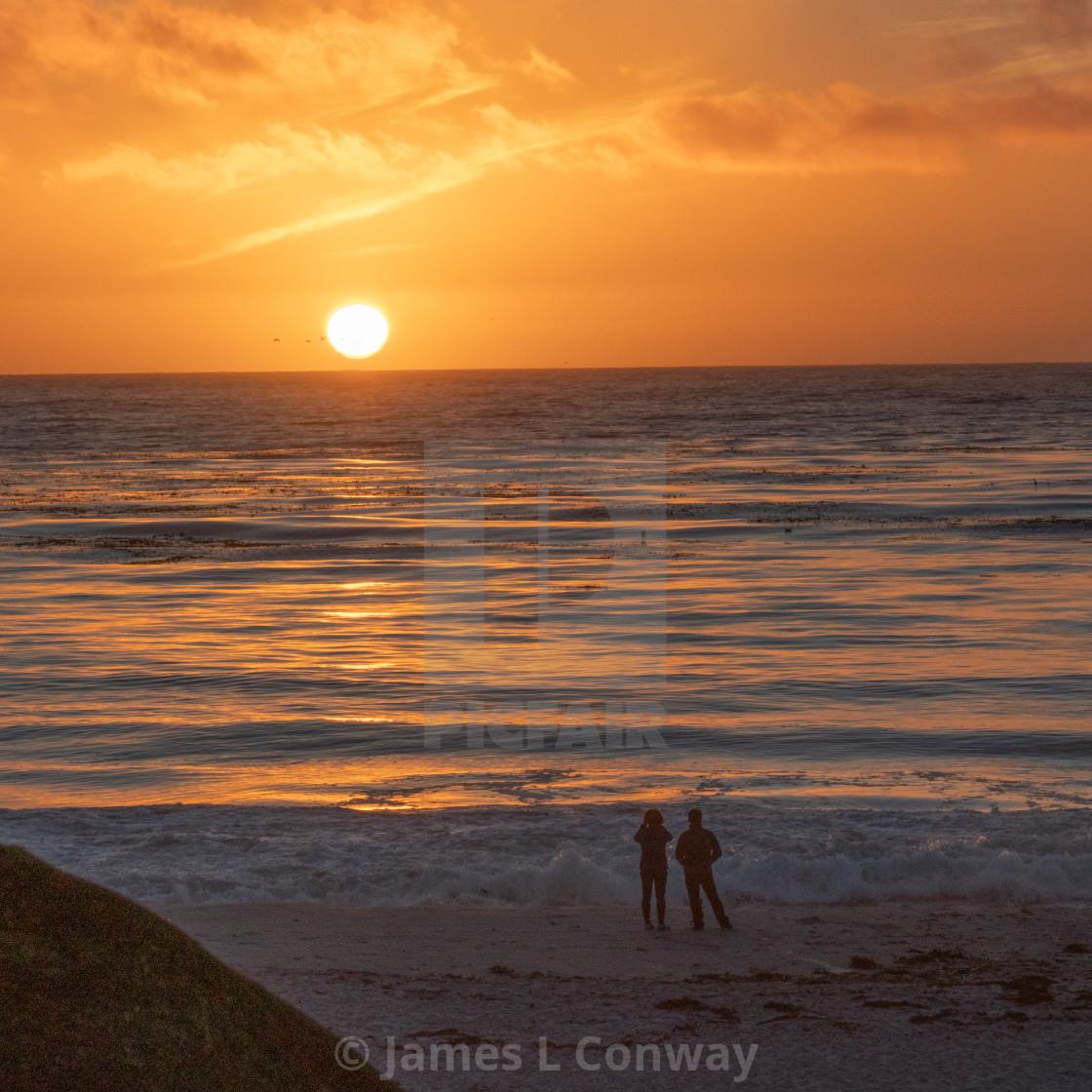 """Lovers enjoy Sunset"" stock image"