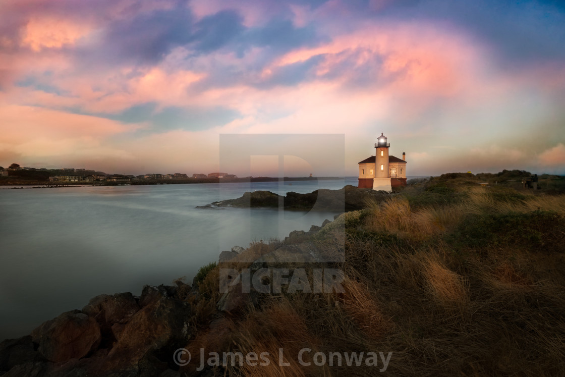 """Lighthouse at Sunrise"" stock image"
