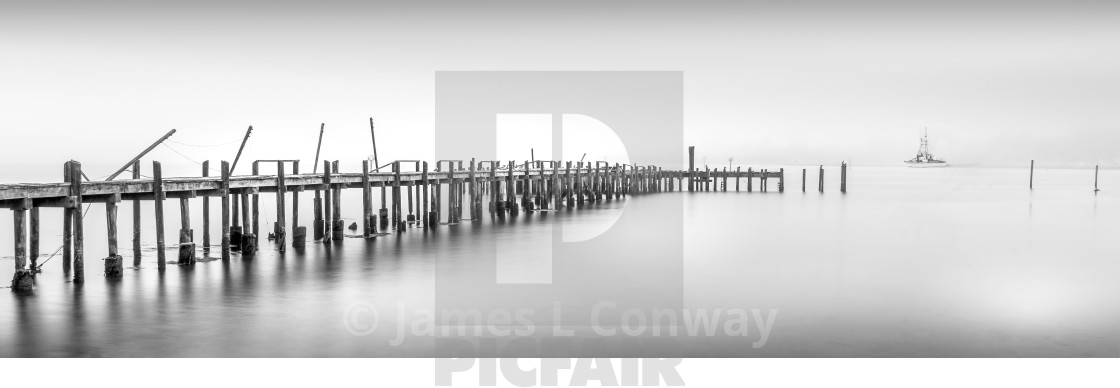 """""""Black and White panorama of pier and fishing boat."""" stock image"""