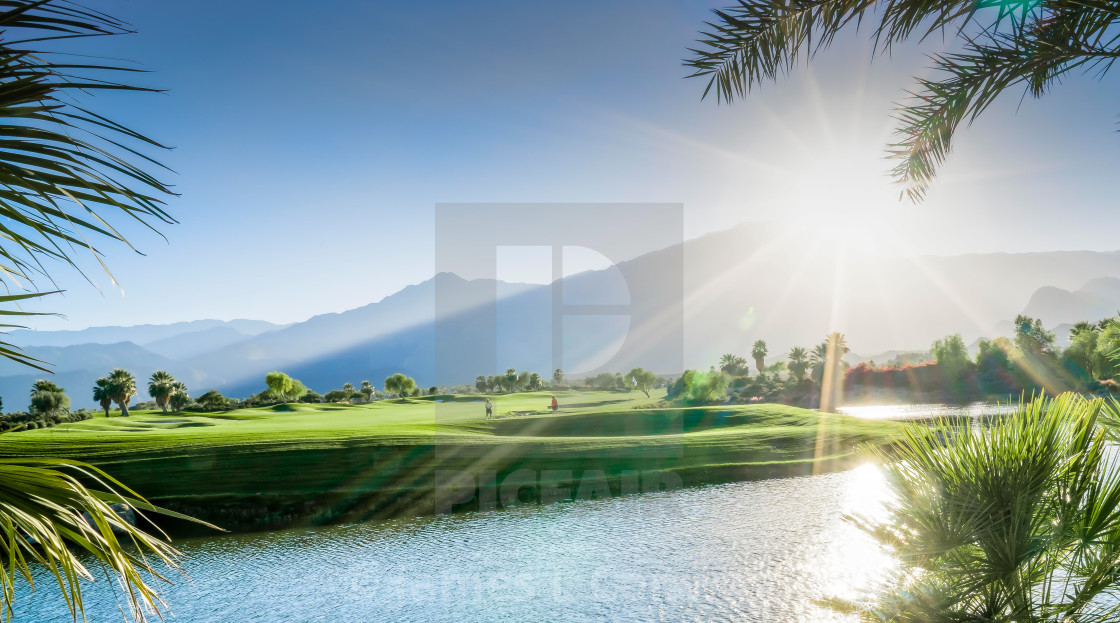 """Sunset over a golf course"" stock image"
