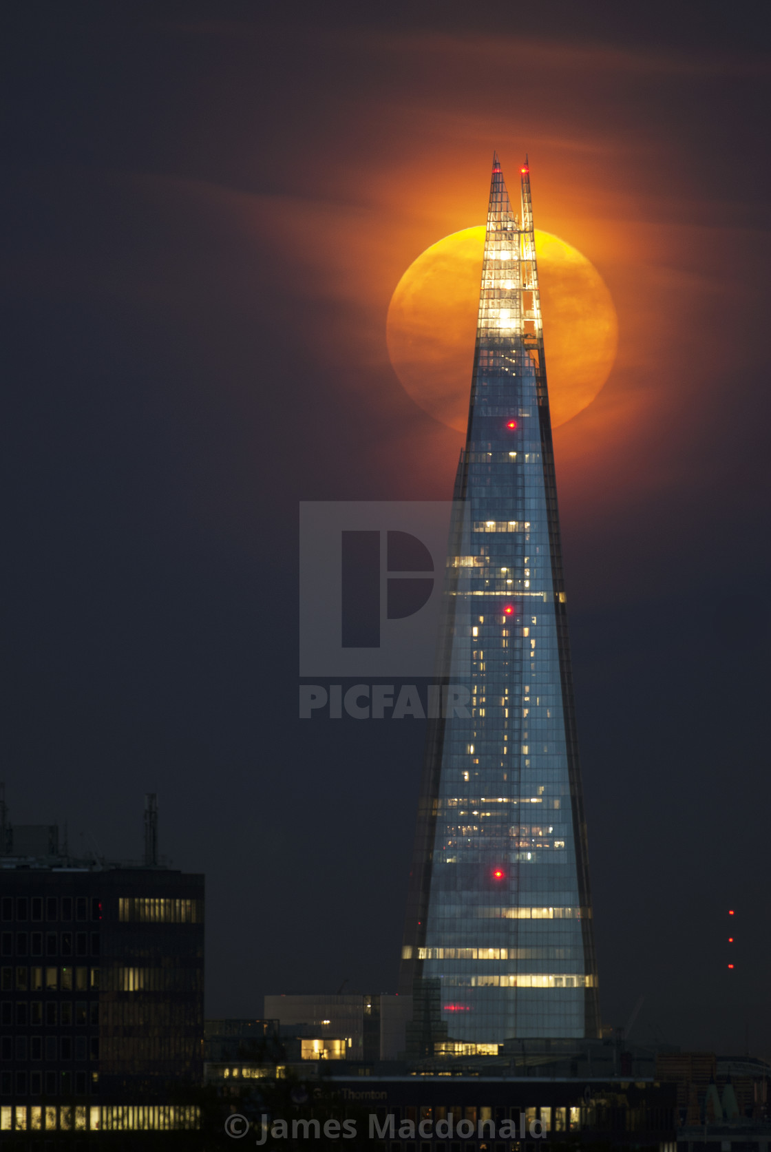 """Moon behind Shard"" stock image"